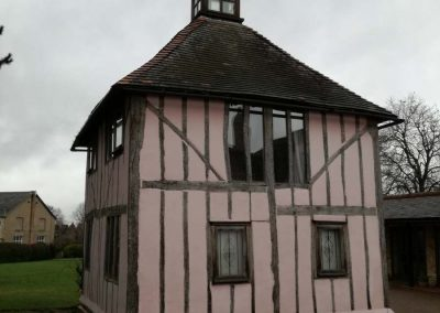Listed ll Pink Building after painted
